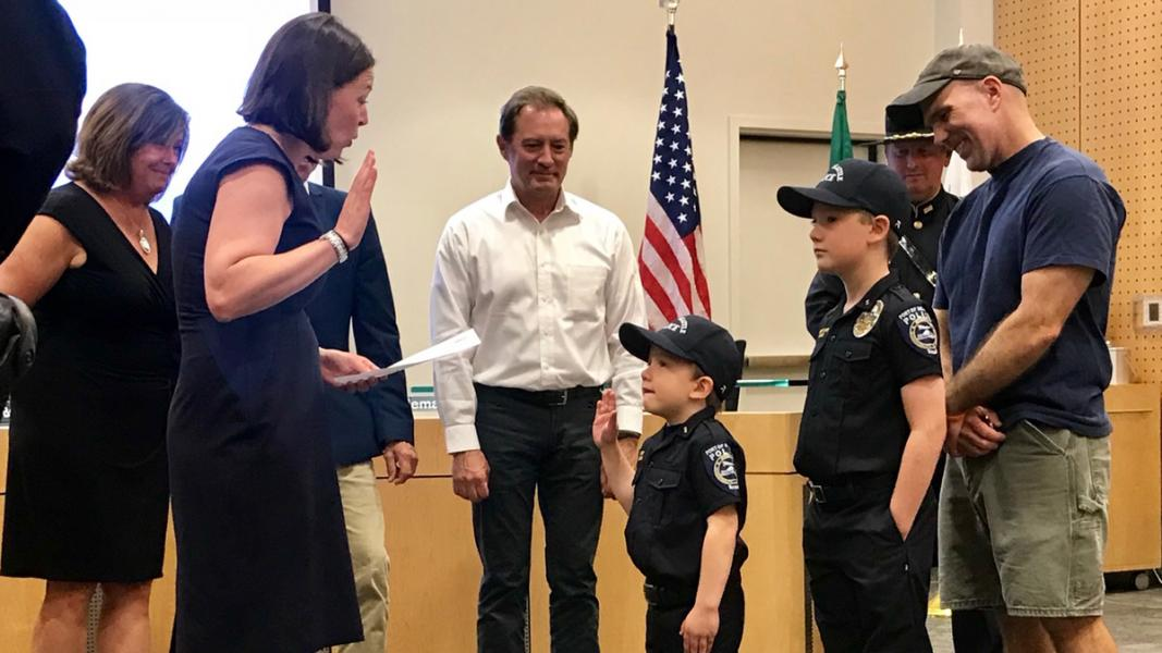 Commissioners swear in youth at the Officer for a Day ceremony