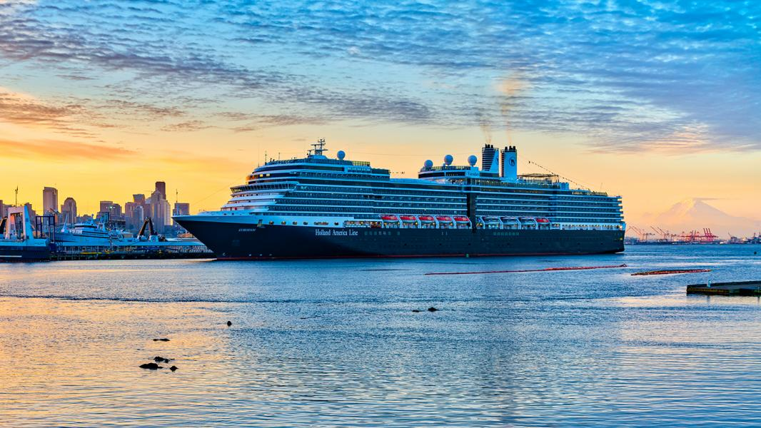 Holland America Eurodam at Terminal 91 with a beautiful orange and yellow sunrise in the background, Seattle, 2016