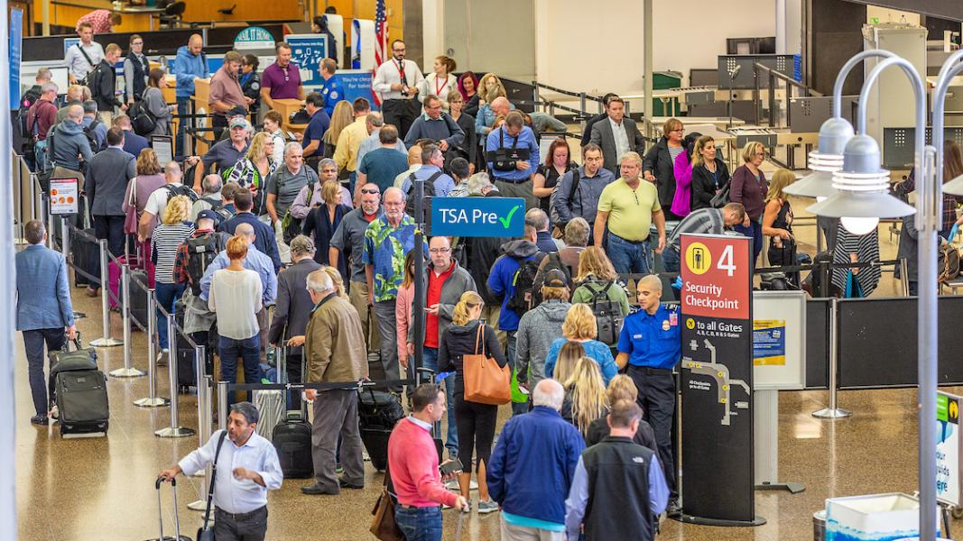 Passengers at Sea-Tac Airport wait in long security lines at Checkpoint 4