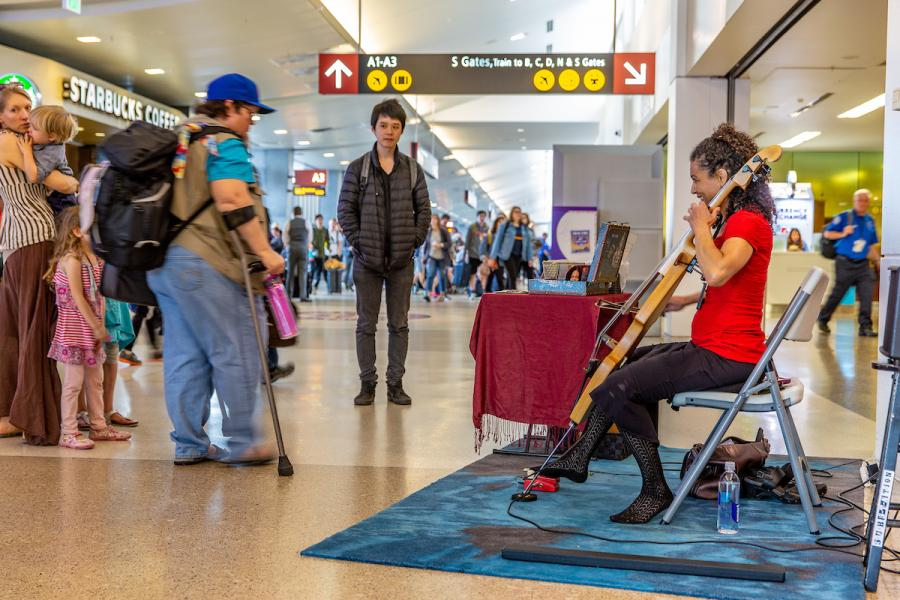 Musician playing in the terminal at Sea-Tac