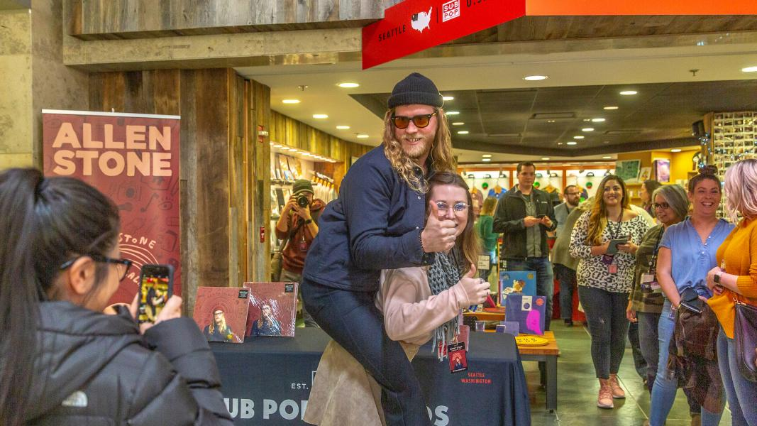 Allen Stone takes photos with fans at Sub Pop records.