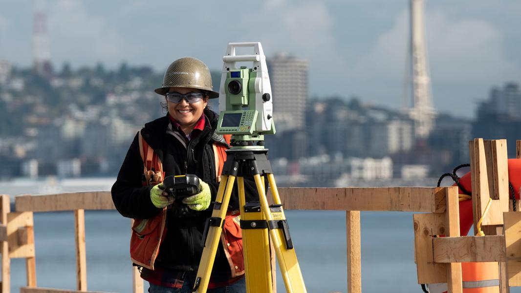 Surveyor at work on the Terminal 5 modernization project, Seattle, July 2019