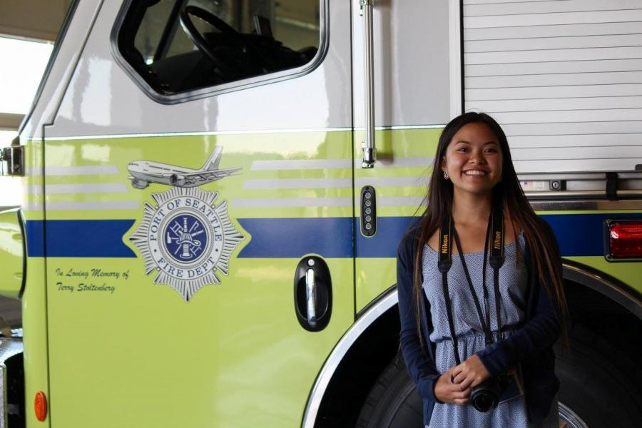 Bryanna Bui in front of a Port fire truck