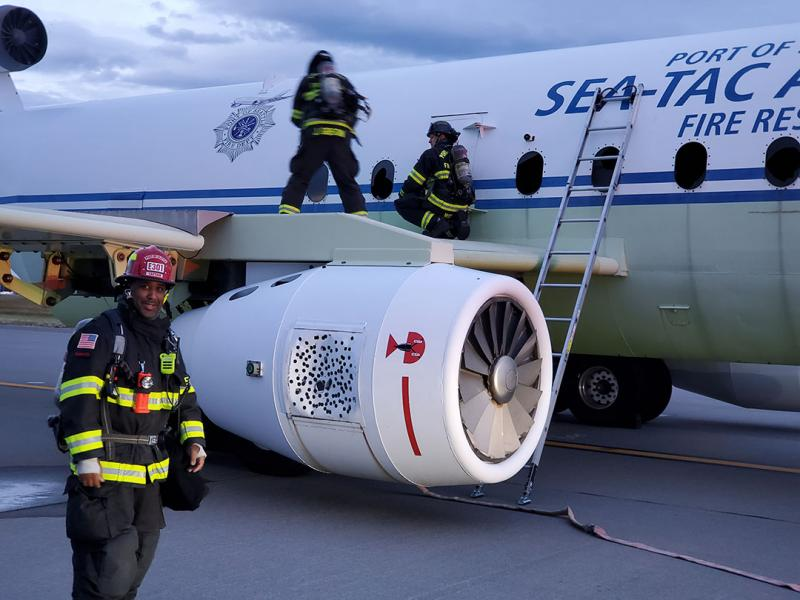 firefighter on aircraft mock up