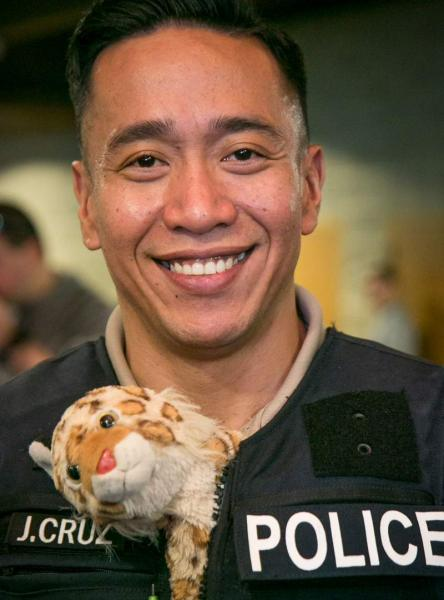 Port of Seattle Police officer and stuffed animal