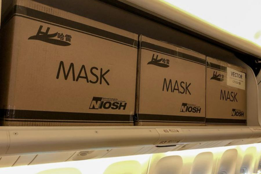 Boxes of masks in the overhead bins