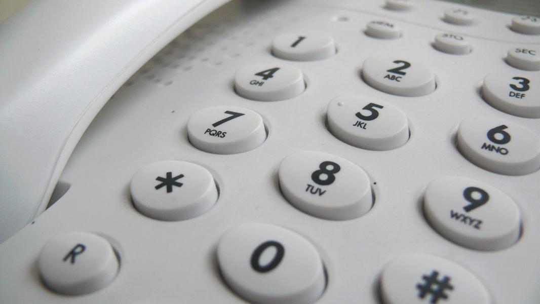 Conventional telephone close up of the dialing numbers
