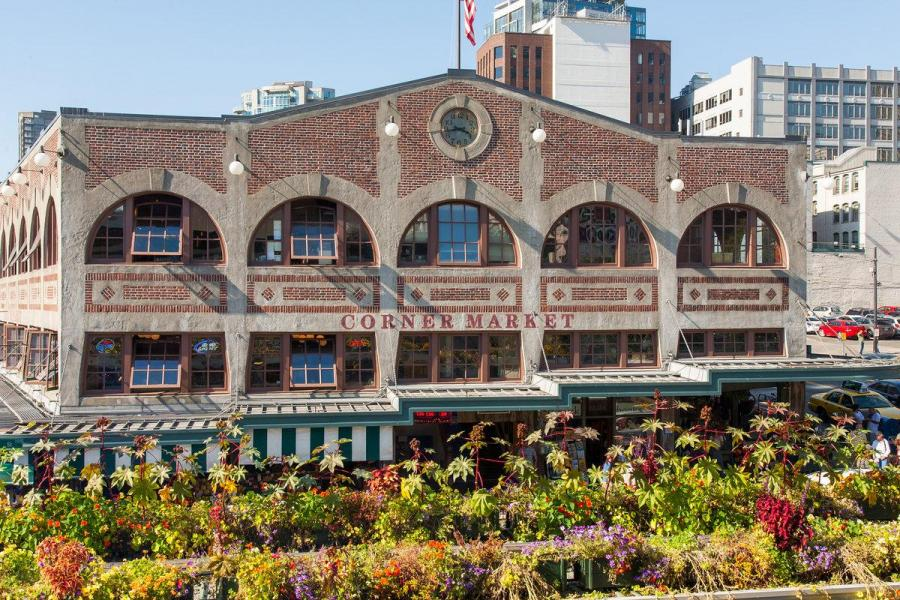 Pike Place market building with flowers