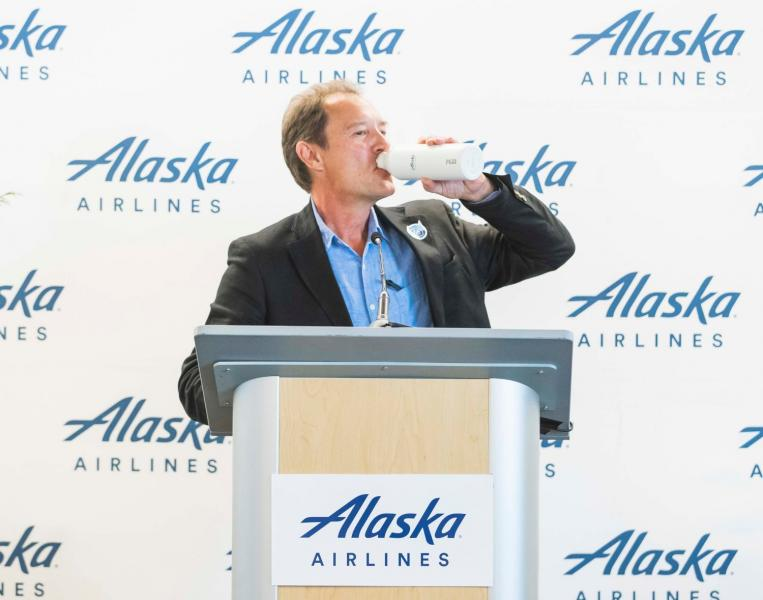 Commissioner Steinbrueck drinks out of a refillable bottle at SEA