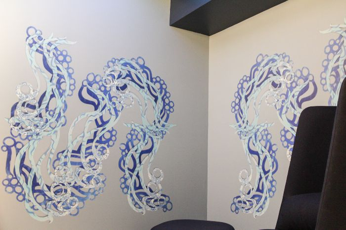 Winding blue artwork on the wall of the SEA sensory room